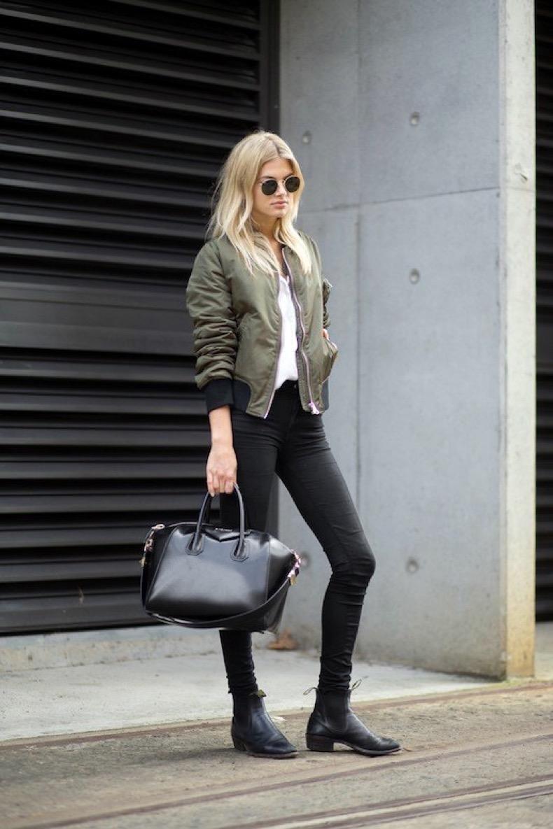 Le-Fashion-Blog-Model-Street-Style-Megan-Irwin-Round-Sunglasses-Green-Bomber-Jacket-Givenchy-Antigona-Bag-Skinny-Jeans-Leather-Boots-Via-Harpers-Bazaar-1
