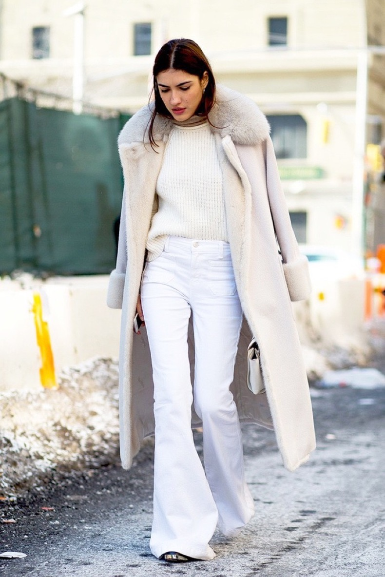 Le-Fashion-Blog-Street-Style-Fashion-Week-Neutrals-Long-Shearling-Coat-Ribbed-Sweater-White-Flared-Jeans-Via-Harpers-Bazaar