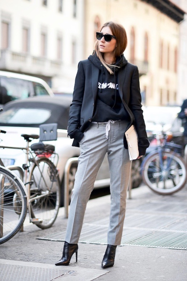 Le-Fashion-Blog-Street-Style-Mfw-Oversized-Blazer-Graphic-Hoodie-White-Clutch-Grey-Pants-Leather-Pointed-Toe-Ankle-Boots-Via-Popsugar