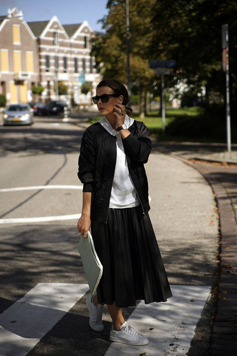 black-pleated-midi-skirt-white-sweatshirt-hoodie-black-baseball-jacket-adidas-sneakers-stan-smiths-black-and-white-clutch-fall-via-ift.tt_