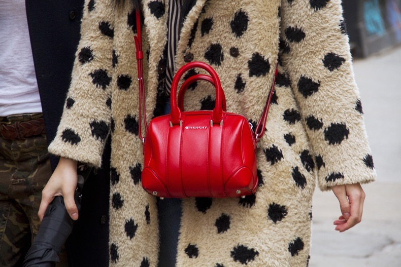 NEW YORK, NY - FEBRUARY 10: Guest seen at The Apartment by The Line outside the Protagonist presentation wearing leopard print coat and red leather Givenchy bag during New York Fashion Week: Women's Fall/Winter 2016 on February 10, 2016 in New York City. (Photo by Georgie Wileman/Getty Images)