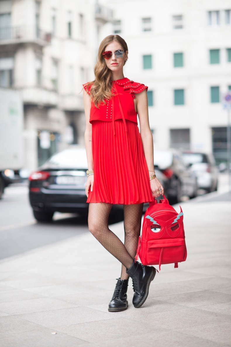 MILAN, ITALY - FEBRUARY 26:  Chiara Ferragni is wearing a Giambattista Valli dress and a Chiara Ferragni Collection backpack  seen in the streets of Paris during the Milan Fashion Week Fall/Winter 2016/17 on February 26, 2016 in Milan, Italy.  (Photo by Timur Emek/Getty Images)