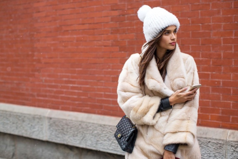model-off-duty-style-double-coats-moto-jacket-fur-coat-beanie-furry-pomp-pom-hat-chanel-bag-winter-outfits-nyfw-street-style-2016-hbz