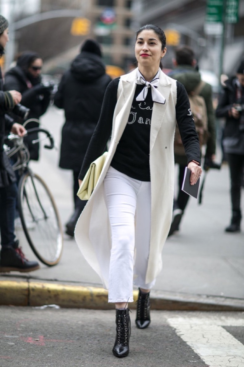 sleeveless-jacket-long-vest-white-jeans-lace-up-booties-graphic-sweatshirt-scarf-around-neck-caroline-issa-work-weekend-nyfw-street-style-ps-640x960