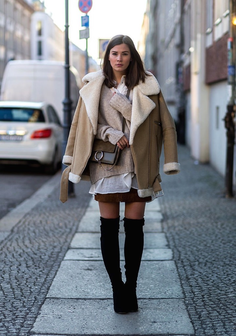 BERLIN, GERMANY - JANUARY 22: Fashion blogger Nina Schwichtenberg of Fashiioncarpet wearing Zara jacket, Edited sweater, H&M blouse, Pepe Jeans skirt, Chloe bag and River Island overknees during the Mercedes-Benz Fashion Week Berlin Autumn/Winter 2016 at Brandenburg Gate on January 22, 2016 in Berlin, Germany. (Photo by Christian Vierig/Getty Images for IMG)