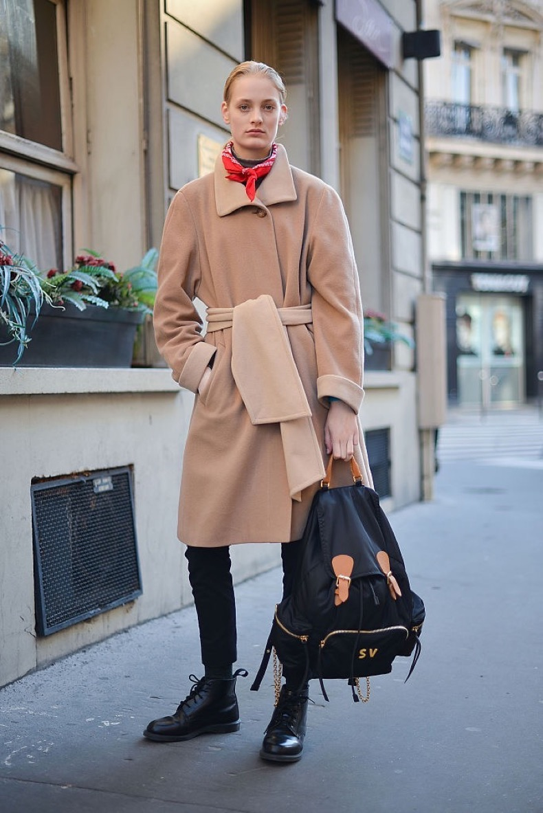 PARIS, FRANCE - JANUARY 25: A model poses wearing a vintage coat, Dr. Martens shoes and Burberry backpack after the Schiaparelli show at Place Vendome during Haute Couture on January 25, 2016 in Paris, France. (Photo by Vanni Bassetti/Getty Images)