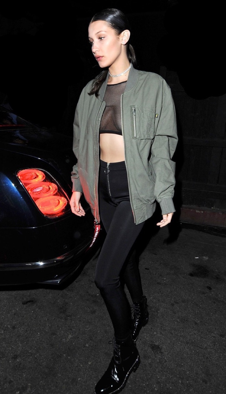 West Hollywood, CA - West Hollywood, CA - Bella Hadid steps out after a night at The Nice Guy in West Hollywood. The 19-year-old model left little to the imagination in an olive green jacket over a mesh crop top, black leggings and matching black boots.   AKM-GSI 16 JUNE 2016  To License These Photos, Please Contact :  Maria Buda  (917) 242-1505  mbuda@akmgsi.com or    Mark Satter  (317) 691-9592  msatter@akmgsi.com  sales@akmgsi.com