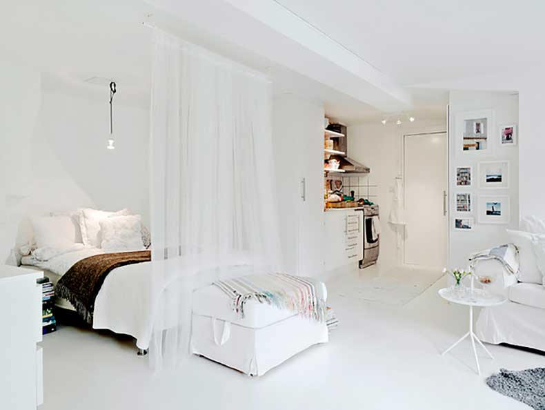 white-one-room-apartment-with-curtain