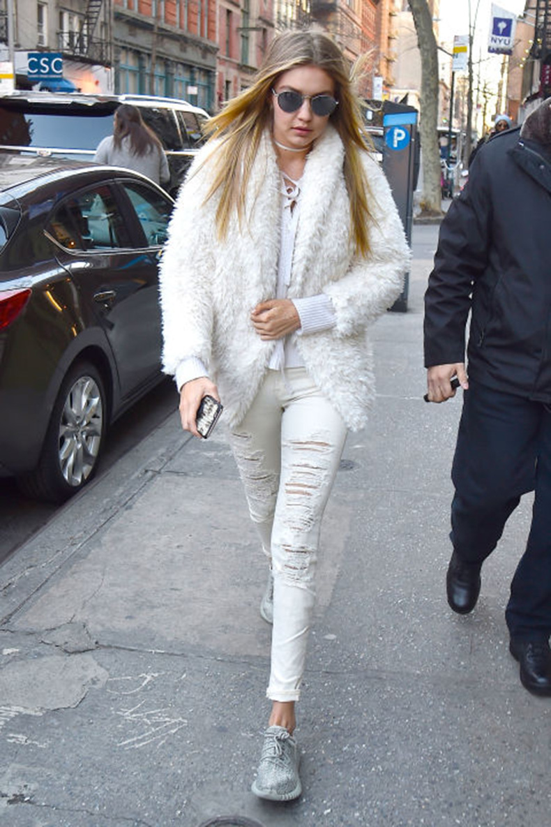 gigi-hadid-white-jeans-winter-whites-tie-front-top-furry-jacket-ripped-jeans-sneakers-weekend-outfit-getty