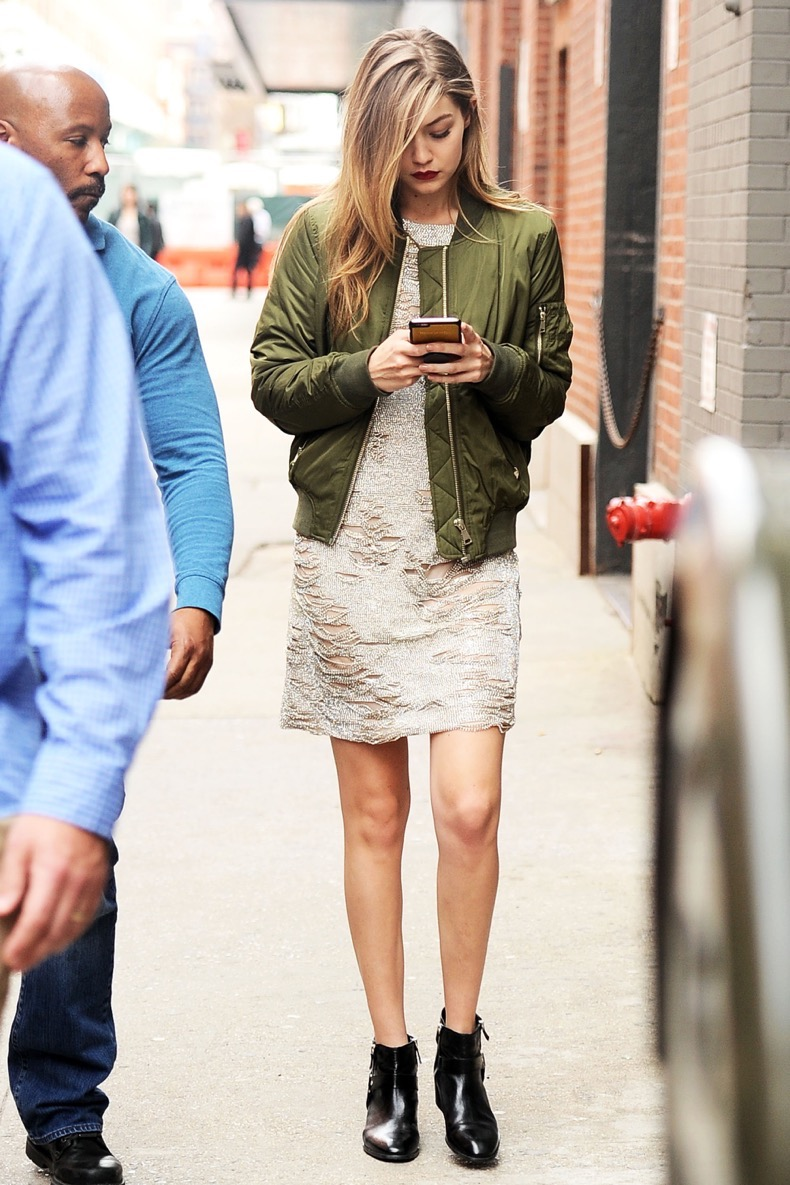 Gigi Hadid steps out looking stunning wearing red lipstick and a gold crystaled dress as she goes to a photoshoot at MILK studios in NYC Pictured: Gigi Hadid Ref: SPL1254558  310316   Picture by: Splash News Splash News and Pictures Los Angeles:310-821-2666 New York:212-619-2666 London:870-934-2666 photodesk@splashnews.com