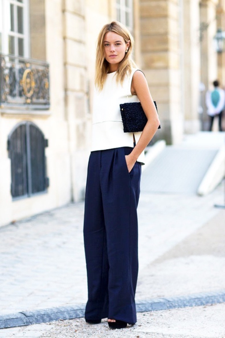 Le-Fashion-Blog-Street-Style-Camille-Rowe-Minimal-Office-Look-White-Sleeveless-Shell-Top-Navy-Wide-Leg-Trousers-Platform-Sandals-Black-Clutch-Via-Harpers-Bazaar