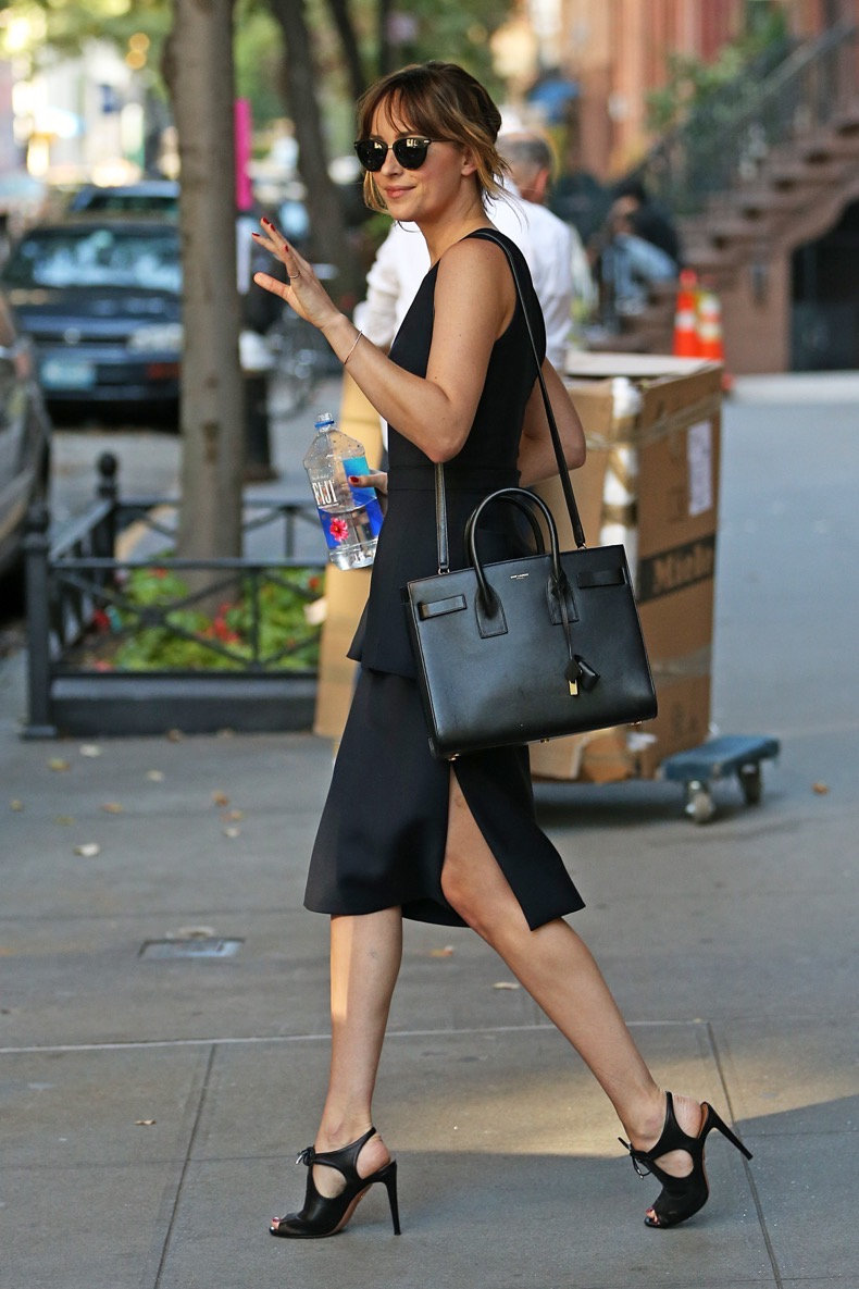 Dakota Johnson heads to Jimmy Fallon wearing a black skirt, NYC Pictured: Dakota Johnson Ref: SPL1128236  160915   Picture by: Splash News Splash News and Pictures Los Angeles:310-821-2666 New York:212-619-2666 London:870-934-2666 photodesk@splashnews.com