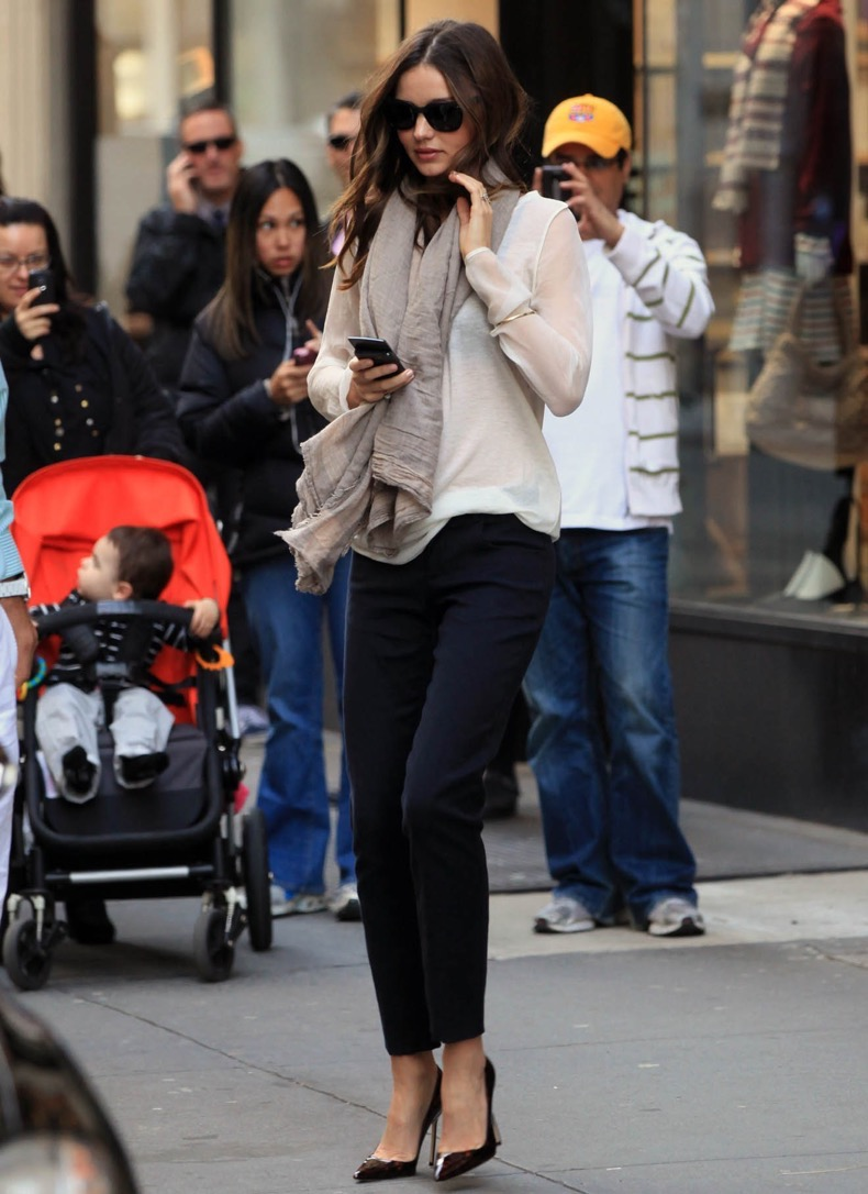 #8117614 Model Miranda Kerr quickly made her way out of her New York City, New York hotel on November 3, 2011 busy on her phone. Fame Pictures, Inc - Santa Monica, CA, USA - +1 (310) 395-0500