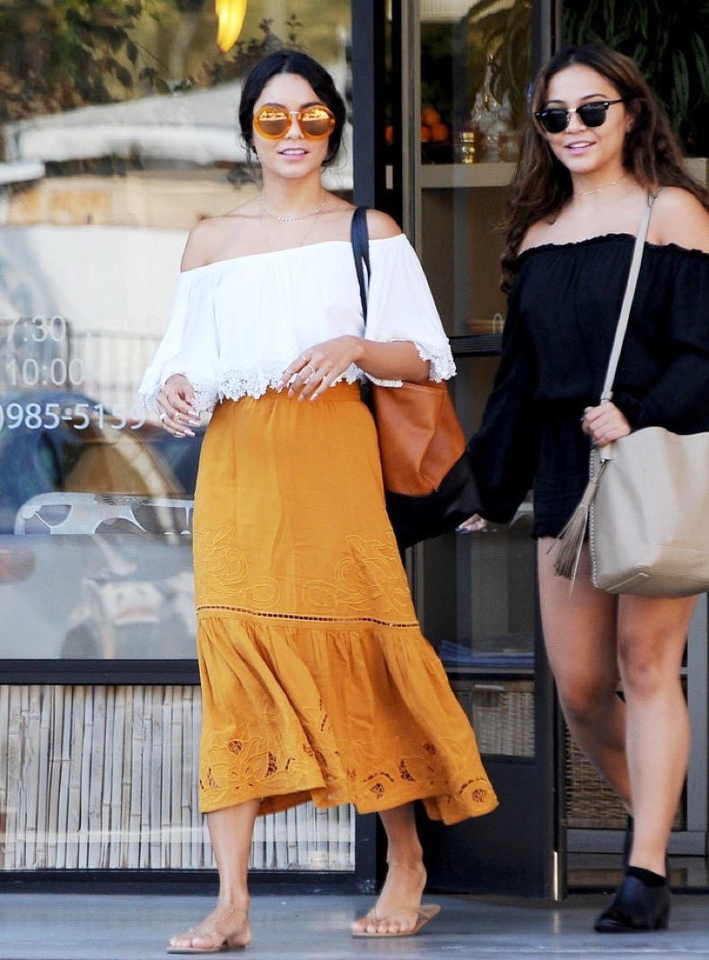 Exclusive... 52138381 Actress Vanessa Hudgens and her friend are seen at a nail salon in Studio City, California on August 1, 2016. She was dressed boho chic in a lacy off the shoulder top and orange skirt. FameFlynet, Inc - Beverly Hills, CA, USA - +1 (310) 505-9876