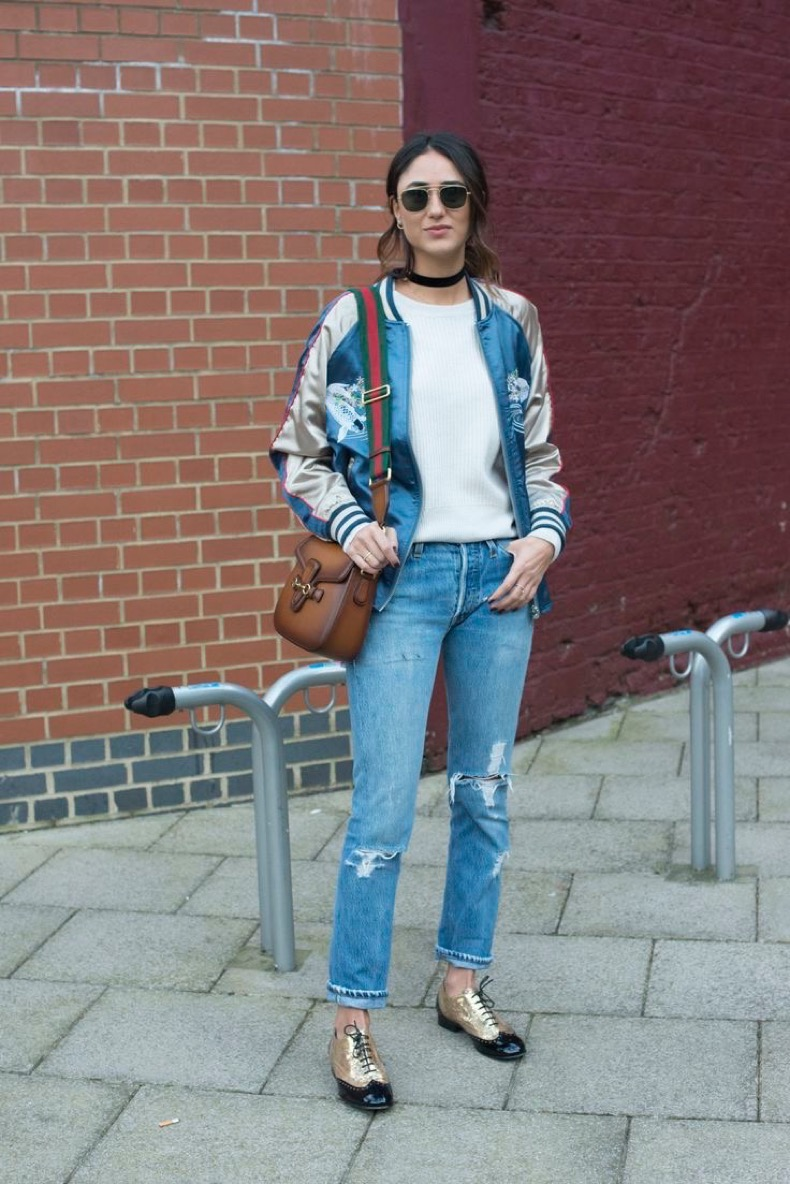 LONDON, ENGLAND - FEBRUARY 23: Fashion blogger Soraya Bakhtiar wears an ASOS bomber jacket, Levi's jeans, IRO sweater, Gucci bag, Chanel shoes and Ray Ban sunglasses on day 5 during London Fashion Week Autumn/Winter 2016/17 on February 23, 2016 in London, England.  (Photo by Kirstin Sinclair/Getty Images)*** Local Caption *** Soraya Bakhtiar