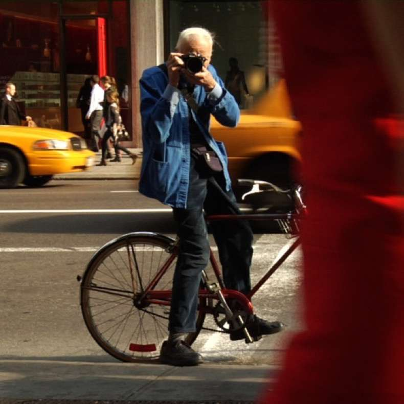 "Bill Cunningham shooting on the street in New York City from the feature-length documentary, ""Bill Cunningham New York,"" ( 2010), directed by Richard Press and produced by Philip Gefter. TO BE USED ONLY WITH PRESS AND PROMOTIONAL COVERAGE OF THE FILM. NOT TO BE USED FOR ANY OTHER PURPOSE WITHOUT PERMISSION FROM THE FILMMAKERS. credit: First Thought Films Contact Philip Gefter: philipgefter@gmail.com"
