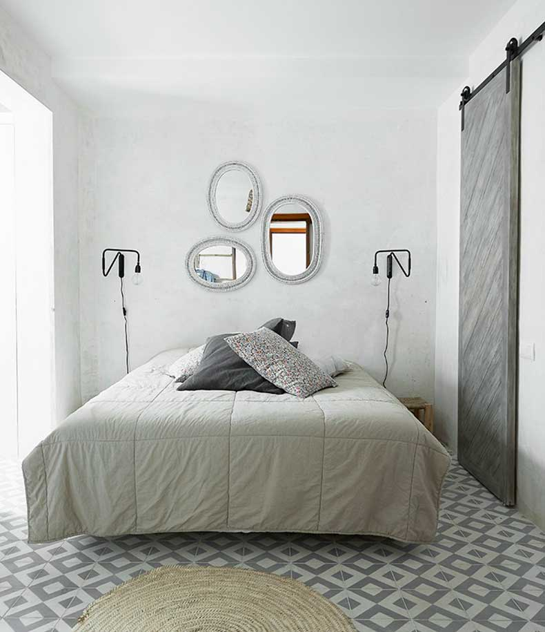 mallorca-apartment-wall-to-wall-cement-tile-bedroom-barn-door-cococozy