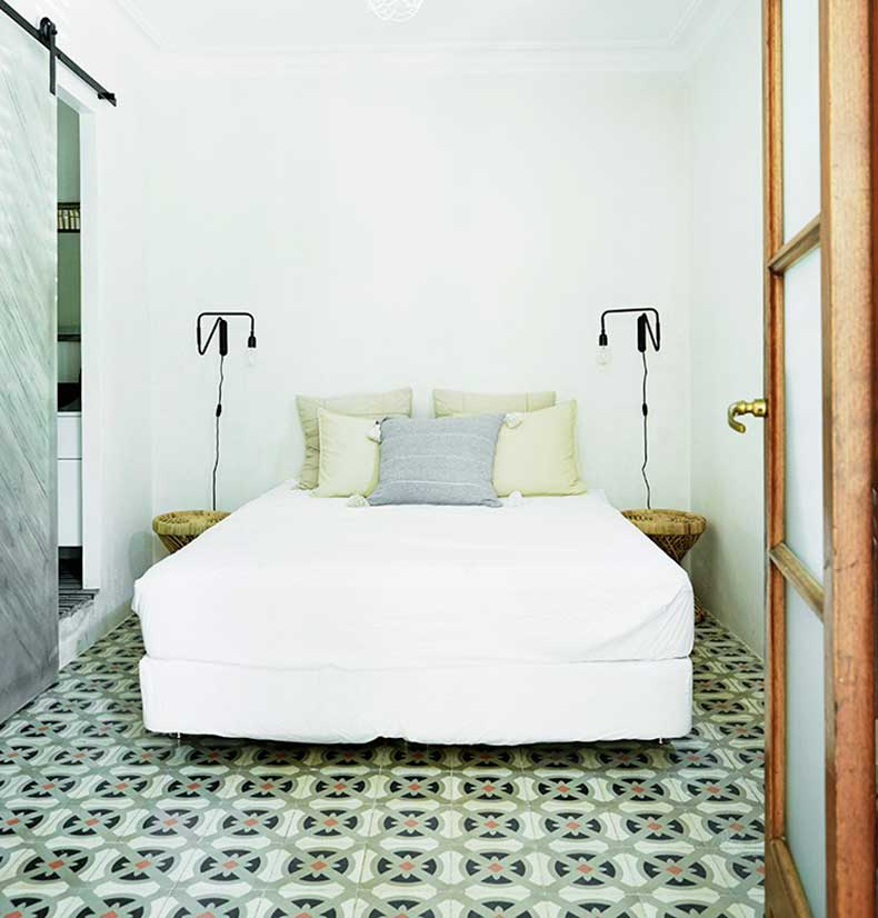 mallorca-apartment-wall-to-wall-cement-tile-guest-bedroom-barn-door-cococozy