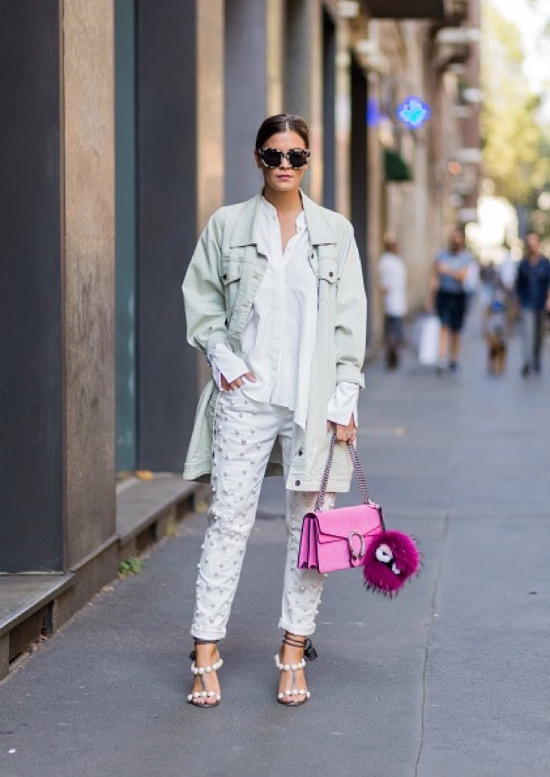 MILAN, ITALY - SEPTEMBER 25: Nina Schwichtenberg wearing a 5 Preview jacket, white blouse and pants and pink Gucci bag outside Dolce & Gabbana during Milan Fashion Week Spring/Summer 2017 on September 25, 2016 in Milan, Italy. (Photo by Christian Vierig/Getty Images)