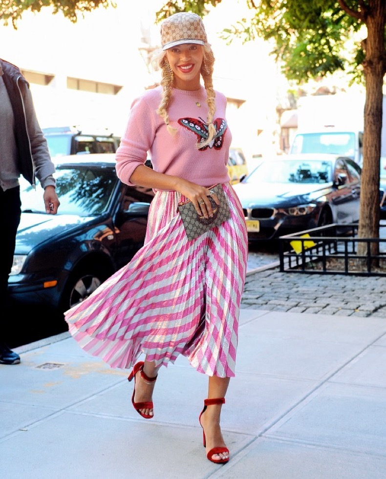 Beyonce is all smiles rocking a pink sweater with a butterfly on it and pink striped dress as she heads to her mothers apartment in NYC Pictured: Beyonce Ref: SPL1368744 051016 Picture by: JENY / Splash News Splash News and Pictures Los Angeles:310-821-2666 New York:212-619-2666 London:870-934-2666 photodesk@splashnews.com