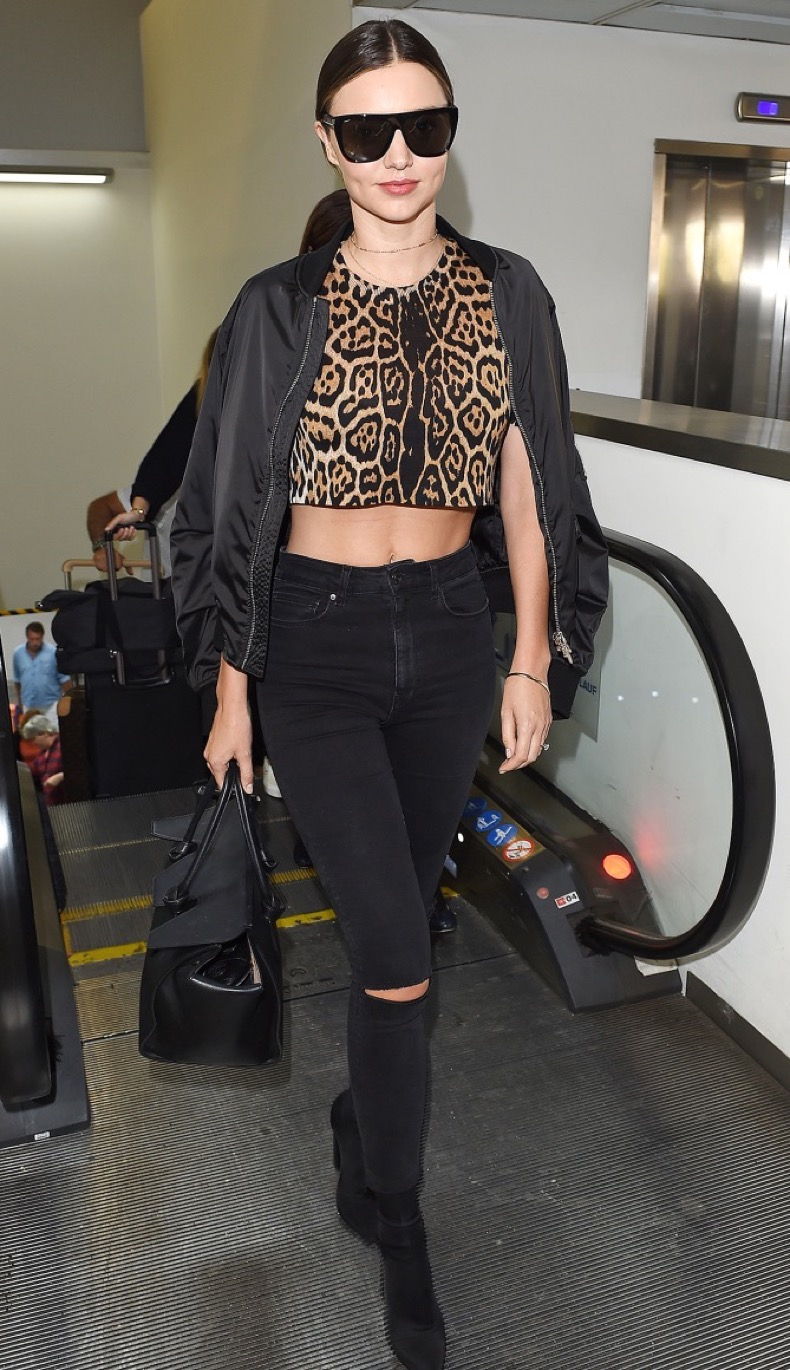 EXCLUSIVE: Miranda Kerr jets into Milan's Malpensa Airport. The 33 year old Antipodean beauty touched down in the Italian fashion capital sporting a leopard print crop-top, torn black jeans and high heeled black ankle boots. The glamorous model and mother of one is in town for Milan Fashion Week.   VIDEO AVAILABLE Please byline:TheImageDirect.com  *EXCLUSIVE PLEASE EMAIL sales@theimagedirect.com FOR FEES BEFORE USE