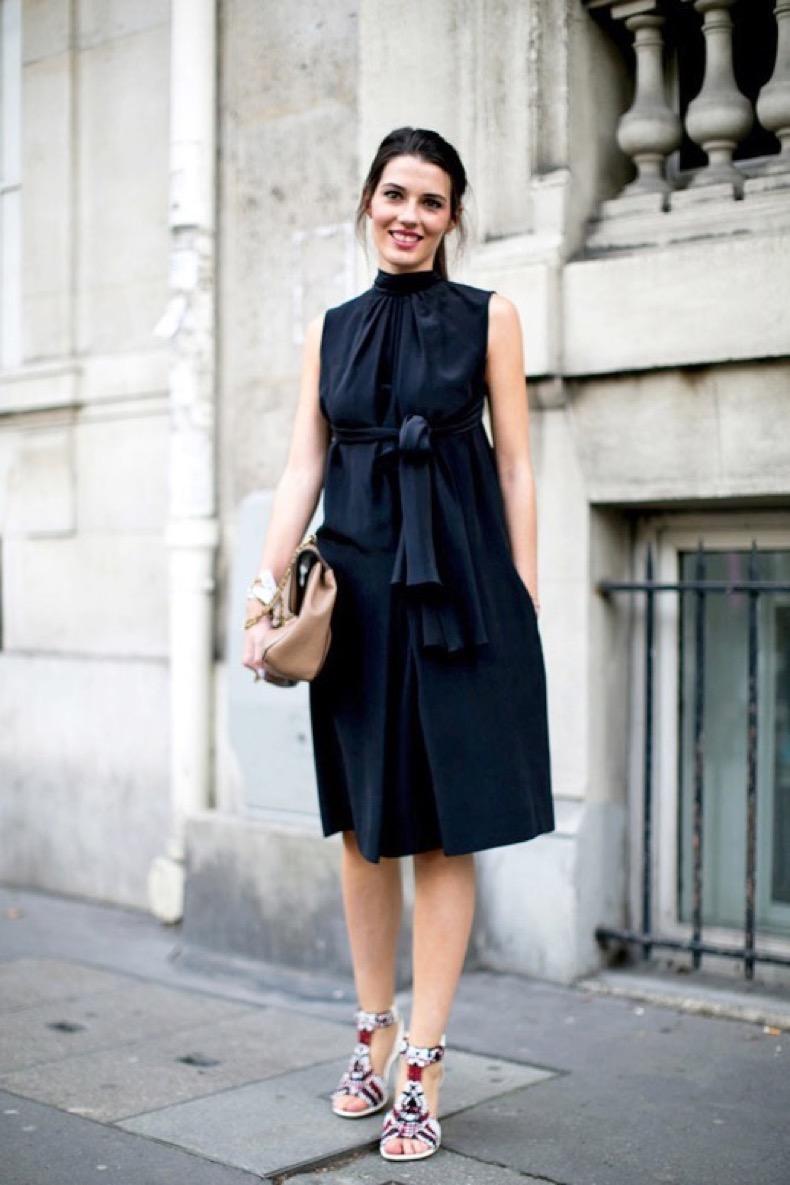 le-fashion-blog-street-style-pfw-black-belted-dress-with-a-high-neck-neutral-bag-embellished-sandals-via-popsugar