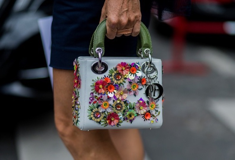 PARIS, FRANCE - JULY 04: A Dior bag outside Dior during Paris Fashion Week Haute Couture F/W 2016/2017 on July 4, 2016 in Paris, France. (Photo by Christian Vierig/Getty Images)