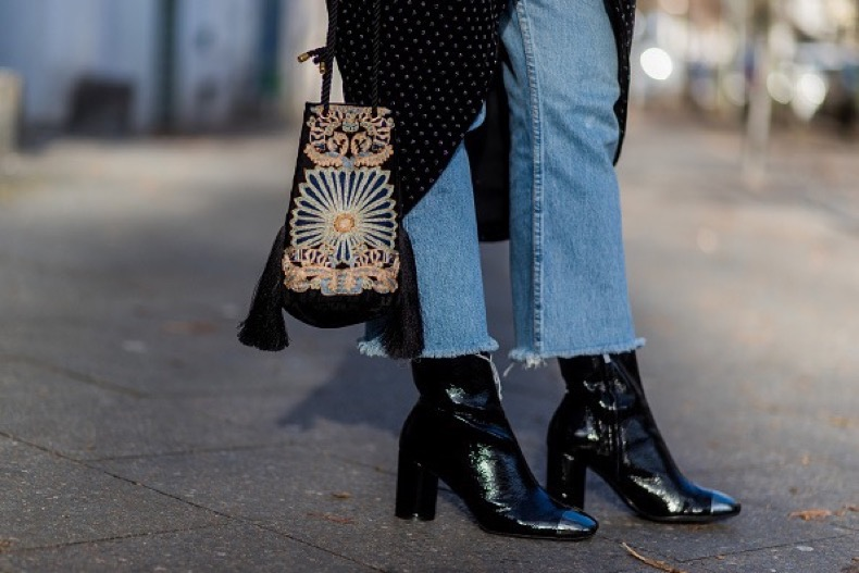 BERLIN, GERMANY - NOVEMBER 21:  Marie Jaster (fashion editor at Journelles / @stylebymarie) wearing a black velvet Zara dress with long sleeves, light blue denim jeans Levis, black Zara heeld boots, a black velvet bag H&M trend, on November 21, 2016 in Berlin, Germany. (Photo by Christian Vierig/Getty Images)