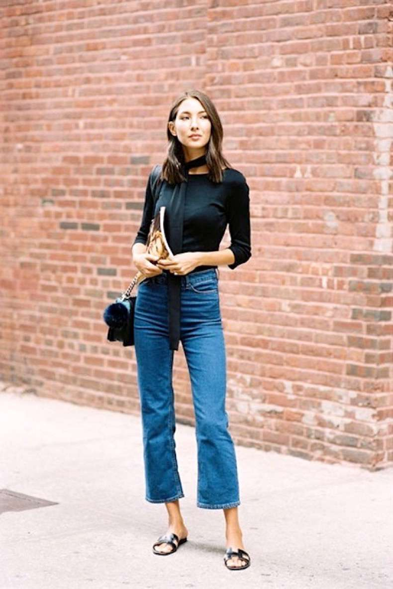 le-fashion-blog-street-style-black-long-skinny-scarf-quarter-sleeve-tee-quilted-bag-with-fur-pom-pom-keychain-kick-flare-denim-hermes-slide-sandals-via-vanessa-jackman_1