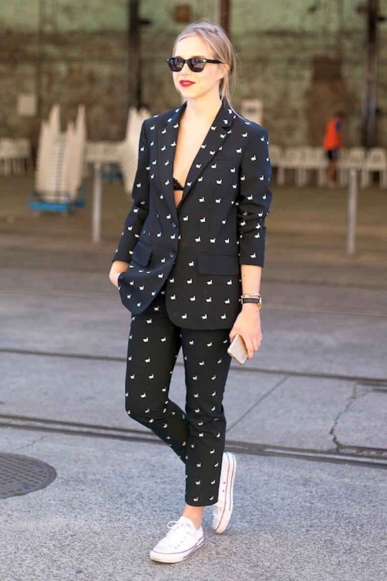 le-fashion-blog-street-style-low-bun-bright-red-lip-printed-tibi-suit-black-lacy-bra-white-converse-sneakers-via-harpers-bazaar