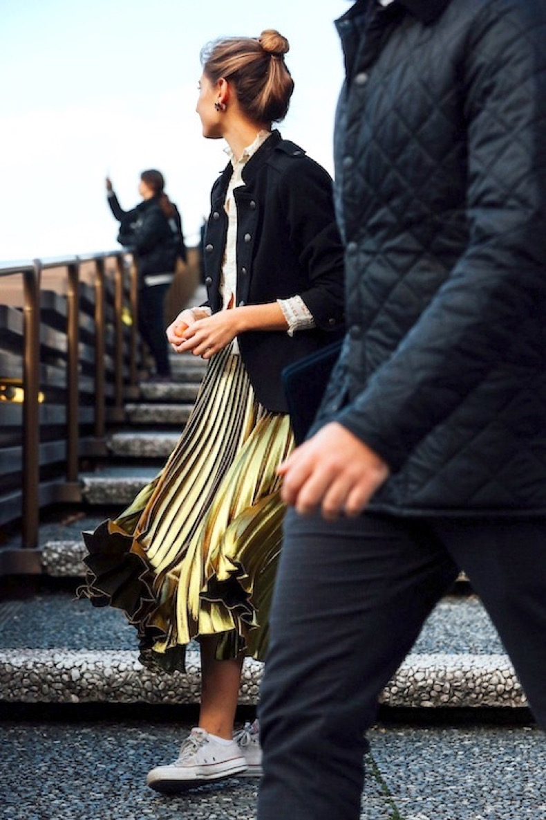 le-fashion-blog-street-style-varsity-jacket-metallic-gold-pleated-skirt-converse-sneakers-via-vogue_1