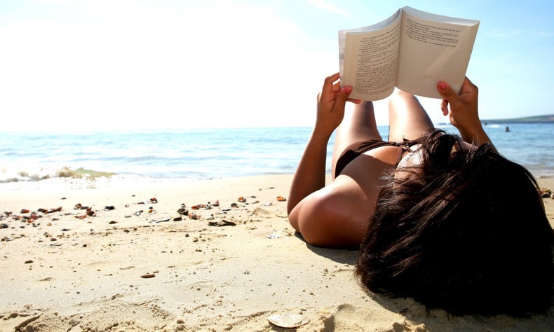 Mandatory Credit: Photo by Martin Lee / Rex Features ( 714523aq ) Model Released - Young Woman Reading Book on Beach Various