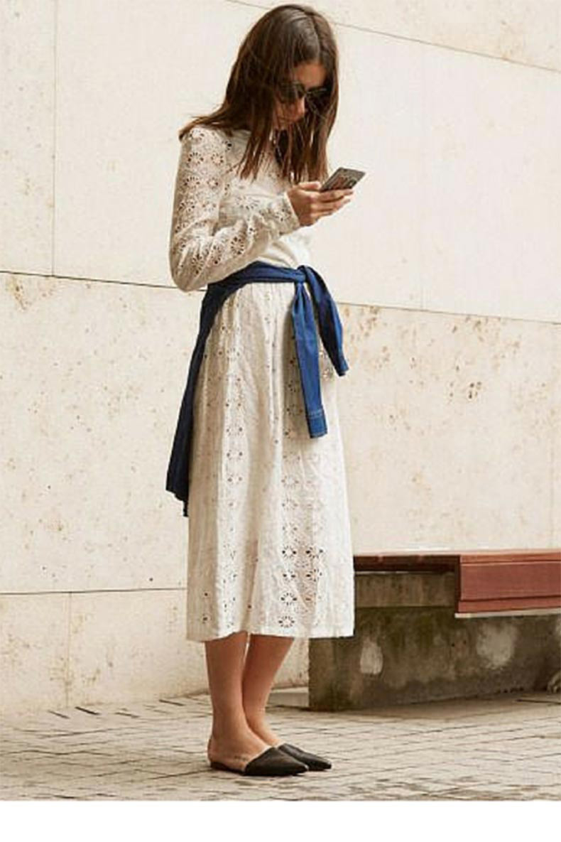 sneakers-an-dpearls-street-style-black-flat-mules-with-a-white-lace-dress-trending-now